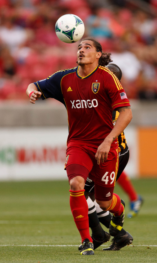 Trent Nelson  |  The Salt Lake Tribune Real Salt Lake's Devon Sandoval with his eye on the ball as Real Salt Lake hosts Charleston Battery in the US Open Cup Wednesday June 12, 2013 at Rio Tinto Stadium in Sandy, Utah.