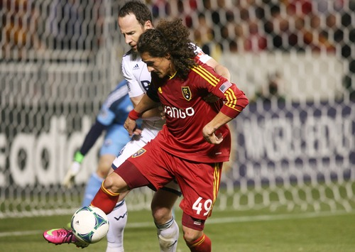 Kim Raff  |  The Salt Lake Tribune (back) Vancouver Whitecaps FC defender Andy O'Brien (40) defends (front) Real Salt Lake forward Devon Sandoval (49) in front of the Vancouver Whitecaps FC goal during a match at Rio Tinto Stadium in Sandy on May 4, 2013.  Real Salt Lake went on to win the game 2-0.