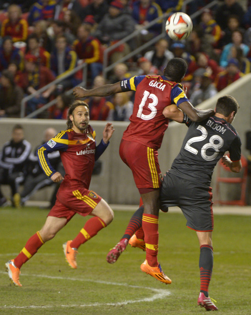 Rick Egan  |  The Salt Lake Tribune  Real Salt Lake midfielder Cole Grossman (12) collides with Toronto FC defender Mark Bloom (28), in MLS action, Real Salt Lake vs. Toronto FC, at Rio Tinto Stadium, Saturday, March 29, 2014