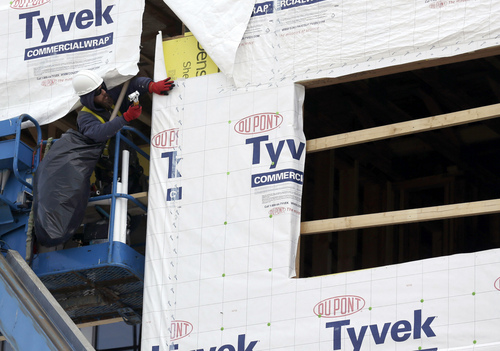 FILE - In this March 26, 2014 photo, a builder works on a home under construction in northwest Chicago. The Commerce Department reports on U.S. home construction in April on Friday. May 16, 2014. (AP Photo/Nam Y. Huh, File)
