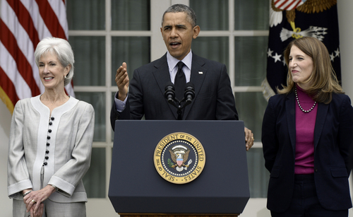 "FILE - This April 11, 2014 file photo shows President Barack Obama, flanked by outgoing Health and Human Services Secretary Kathleen Sebelius, left, and his nominee to replace her, current Budget Director Sylvia Mathews Burwell, speaking in the Rose Garden of the White House in Washington. There's a new health insurance term in the glossary, and it could mean thousands of dollars out of your pocket. It's a cost-control strategy called ""reference pricing."" It puts a hard dollar limit on what health plans pay for certain expensive procedures _ like knee and hip replacements. The Obama administration has given the go-ahead for insurers and employers to use the approach, setting aside some legal concerns. (AP Photo/Susan Walsh, File)"