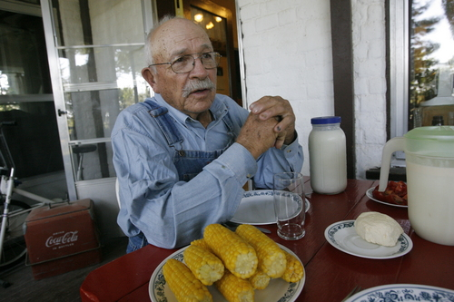 Rick Egan  |  The Salt Lake Tribune  Cecil Garland sits down for lunch on the patio of his home on his ranch in Callao, Friday, August 21, 2009.
