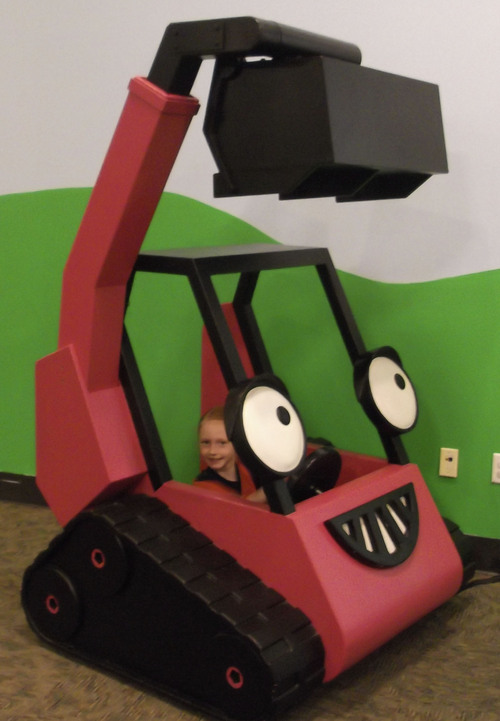 "Sean P. Means  |  The Salt Lake Tribune Kaylee Parker, 7, a student at Ranches Academy in Eagle Mountain, ""drives"" Benny, an excavator, in the new interactive exhibit, ""Bob the Builder - Project: Build It,"" opening Saturday, May 17, at Discovery Gateway in Salt Lake City."