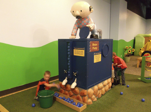 "Sean P. Means  |  The Salt Lake Tribune Children from Ranches Academy in Eagle Mountain fill Farmer Pickles' water pump in the new interactive exhibit, ""Bob the Builder - Project: Build It,"" opening Saturday, May 17, at Discovery Gateway in Salt Lake City."