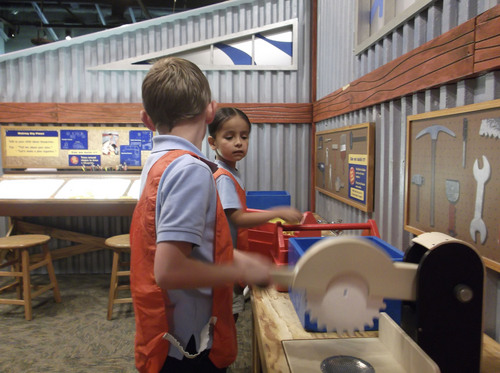 "Sean P. Means  |  The Salt Lake Tribune Children from Ranches Academy in Eagle Mountain try out Bob's workshop in the new interactive exhibit, ""Bob the Builder - Project: Build It,"" opening Saturday, May 17, at Discovery Gateway in Salt Lake City."
