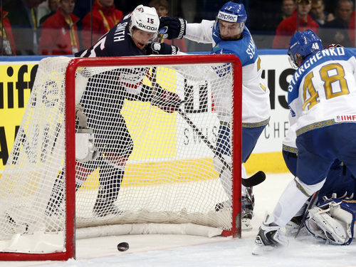 USA forward Craig Smith, left, scores during the Group B preliminary round match between USA and Kazakhstan at the Ice Hockey World Championship in Minsk, Belarus, Friday, May 16, 2014. (AP Photo/Darko Bandic)