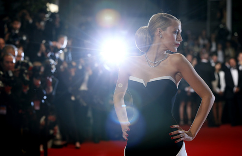 Actress Blake Lively poses for photographers as she arrives for the screening of Captives at the 67th international film festival, Cannes, southern France, Friday, May 16, 2014. (AP Photo/Alastair Grant)