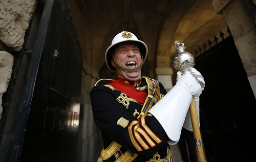 Royal Marines Drum Major Warrant Officer Class 1 James 'Wiggy' Whitwham , who is due to retire after 34 years with the Royal Marines, laughs during a media opportunity at Horse Guards Parade in London, Friday, May 16, 2014. Whitwham went to inspect the parade ground ahead of his last performance at Beating the Retreat on June 3-4. He was joined by representatives from the United States and Netherlands embassies in the UK. (AP Photo/Kirsty Wigglesworth)