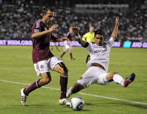 Colorado Rapids defender Pablo Mastroeni, left, and Los Angeles Galaxy's A.J. DeLaGarza battle for the ball during the second half of their MLS soccer match, Friday, Sept. 9, 2011, in Carson, Calif. The Galaxy won 1-0. (AP Photo/Mark J. Terrill)