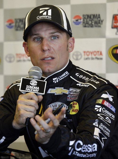Jamie McMurray speaks during a media conference after qualifying for the pole position in the NASCAR Sprint Cup series auto race Saturday, June 22, 2013, in Sonoma, Calif.  (AP Photo/Ben Margot)