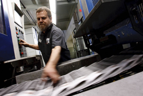 Leah Hogsten  |  The Salt Lake Tribune Media News printing facility MediaOne pressmen Bruce Gallespie print the Mormon Times in 2011, in West Valley City. The U.S. Department of Justice is reportedly scrutinizing a business deal signed in fall 2013 that sold The Salt Lake Tribune's share of the printing facilities and renegotiated its portion of profits from a partnership with its competitor, the Mormon church-owned Deseret News.