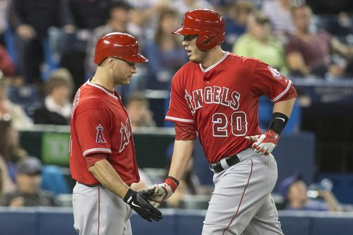 Los Angeles Angels' C.J. Cron, right, is congratulated by Chris Iannetta after hitting a solo home run against the Toronto Blue Jays during the third inning of a baseball game in Toronto on Saturday, May 10, 2014. (AP Photo/The Canadian Press, Chris Young)