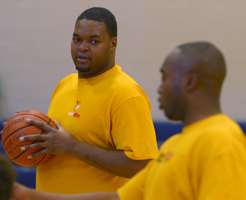 Leah Hogsten  |  The Salt Lake Tribune Former Utah Jazz center Robert Whaley directs young basketball players as a coach with Ronnie Ross (right) of Utah Elite, Tuesday, May 13, 2014. Whaley played in 23 games for the Jazz during the 2005-06 season.