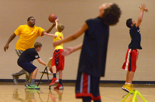 Leah Hogsten  |  The Salt Lake Tribune Former Utah Jazz center Robert Whaley directs young basketball players as coach of Utah Elite, Tuesday, May 13, 2014. Whaley played in 23 games for the Jazz during the 2005-06 season.