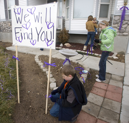 Al Hartmann     The Salt Lake Tribune  On Jan 26, 2010, friends and family of Susan Powell put purple ribbons around her home and signs saying that she is loved, missed and that she will be found.