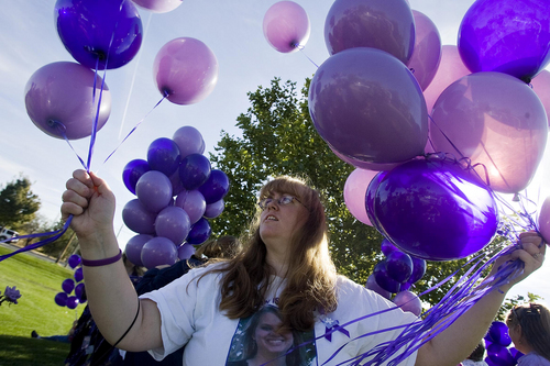 Djamila Grossman     The Salt Lake Tribune  Kiirsi Hellewell, one of the best friends of Susan Cox Powell, untangles balloons before they are released, to mark Powell's birthday at West View Park, in West Valley City, Saturday, Oct. 16, 2010.