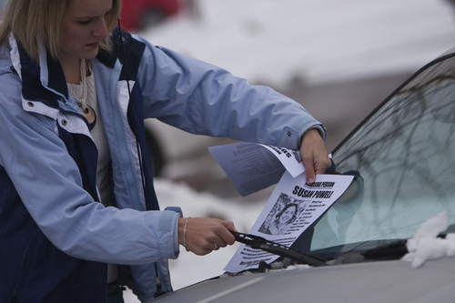 Chris Detrick     The Salt Lake Tribune  Tami Allen hands out 'missing person' fliers on cars in a Smith's parking lot Saturday Dec. 12, 2009. Susan Powell, 28, was seen that previous Sunday at her home and was reported missing by her relatives the next day.