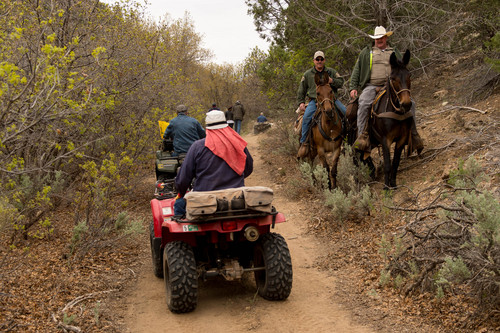 Trent Nelson  |  The Salt Lake Tribune Mounted sheriff's deputies move off the trail as ATV riders make their way into Recapture Canyon, which has been closed to motorized use since 2007. The ATV protest ride on Saturday, May 10, 2014, north of Blanding, came after a call-to-action by San Juan County Commissioner Phil Lyman.
