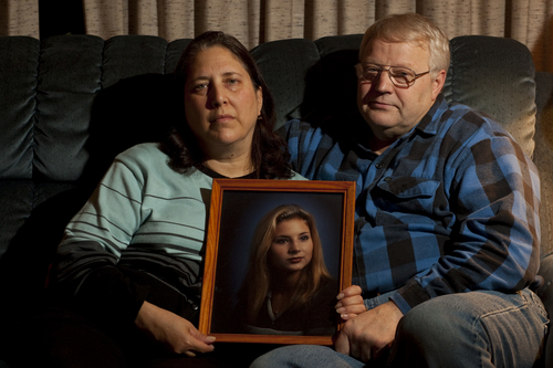Chris Detrick  |  The Salt Lake Tribune  Susan Powell's parents, Judy and Chuck Cox, hold a portrait of their daughter Susan at their home in Puyallup, Wash.