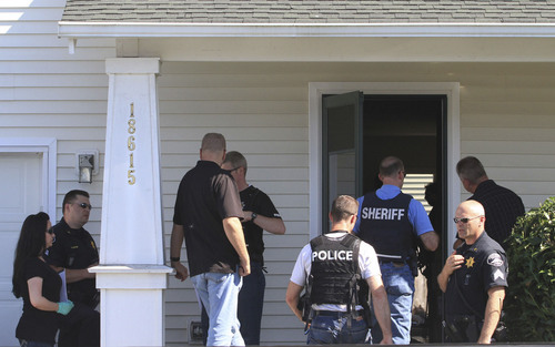 Dean J. Koepfler  |  The Associated Press About two dozen law enforcement office officers from the West Valley City Utah Police Department and Pierce County Sheriff's Department investigate the home of Josh Powell, husband of missing Utah mom Susan Powell, and his father Steve Powell in Puyallup, Wash.