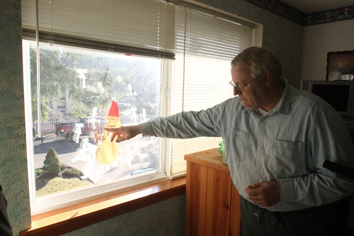 Rick Egan  | The Salt Lake Tribune   Chuck Cox, father of Susan Powell, points to a snowman and snow flakes that Charlie made, in the window of thier room,  in his home in Puyallup, Washington, Monday, February 6, 2012.