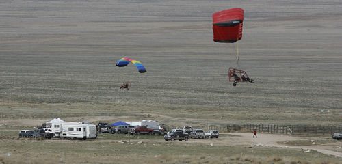 "Scott Sommerdorf  |  The Salt Lake Tribune  Ultralight pilots flying ""flying parachutes"" prepare to land near the command post Saturday as searchers scoured Utah's West Desert for signs of Susan Powell."