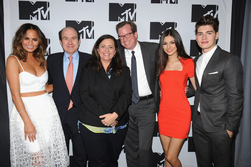 """FILE - This April 24, 2014 file photo shows, from left, Chrissy Teigen of MTV's """"Snack Off"""", CEO of Viacom Philippe Dauman, President of Programming for MTV Susanne Daniels, COO of Viacom Tom Dooley, Victoria Justice of MTV's """"Eye Candy"""" and Gregg Sulkin of MTV's """"Faking It"""" during the 2014 MTV Upfront Presentation in New York. MTV is maturing into a more traditional television network with a broad mix of scripted and reality programming and, in Daniels, has a seasoned television executive in charge of content. (AP Photo/ MTV, Scott Gries, File)"""