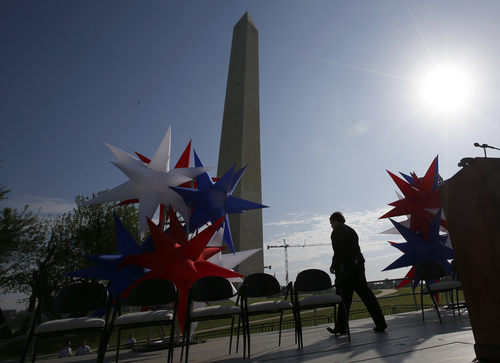 Preparations continue on the stage at the Washington Monument in Washington, Monday, May 12, 2014, ahead of a ceremony to celebrate its re-opening. The monument, which sustained damage from an earthquake in August 2011, is reopening to the public today. (AP Photo)