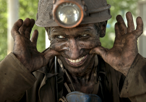 A Ukrainian coal miner smiles, after finishing his shift at a coal mine outside Donetsk, Ukraine, Tuesday, May 20, 2014. While steel worker in Mariupol joined anti-separatist actions, miners refused to take part in a planned protest against the Donetsk People's Republic. (AP Photo/Vadim Ghirda)