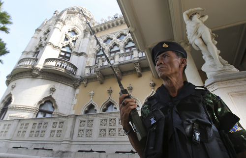 A Thai soldier guards outside Government House compound of prime minister's office,in Bangkok, Thailand, Tuesday, May 20, 2014. Thailand's army declared martial law before dawn Tuesday in a surprise announcement it said was aimed at keeping the country stable after six months of turbulent political unrest. The military, however, insisted a coup d'etat was not underway. (AP Photo/Sakchai Lalit)