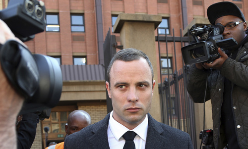 Oscar Pistorius leaves the high court in Pretoria, South Africa, Tuesday, May 20, 2014. Pistorius is charged with murder for the shooting death of his girlfriend, Reeva Steenkamp, on Valentines Day in 2013. (AP Photo/Themba Hadebe)