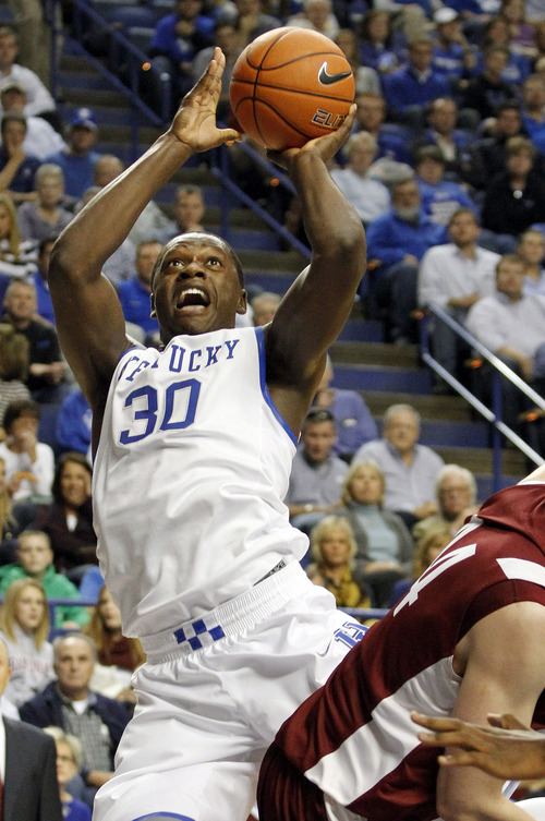 Kentucky's Julius Randle (30) shoots over Transylvania's Joe Jennings during the first half of an exhibition NCAA basketball game, Friday, Nov. 1, 2013, in Lexington, Ky. (AP Photo/James Crisp)