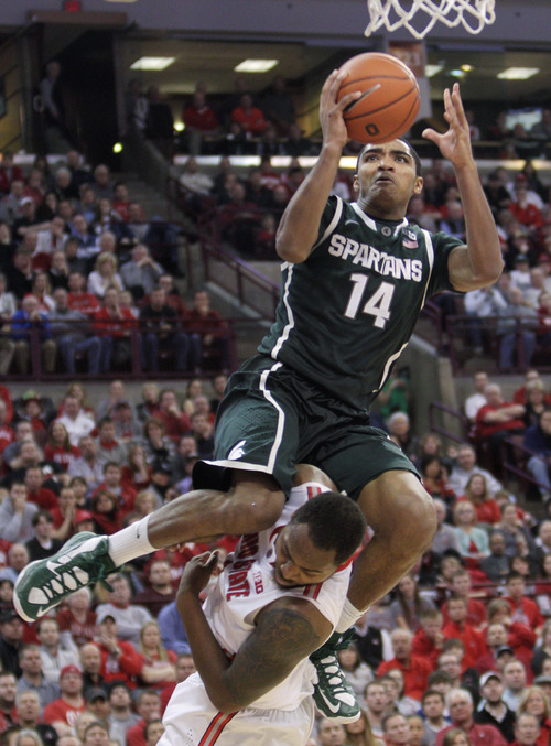 Michigan State's Gary Harris, top, shoots over Ohio State's Deshaun Thomas during the second half of an NCAA college basketball game Sunday, Feb. 24, 2013, in Columbus, Ohio. Ohio State beat Michigan State 68-60. (AP Photo/Jay LaPrete)