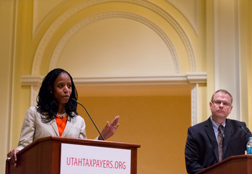 Trent Nelson  |  The Salt Lake Tribune Utah 4th Congressional District Candidates Mia Love and Doug Owens share the stage for a debate at the annual Utah Taxes Now Conference at the Grand America Hotel in Salt Lake City Tuesday May 20, 2014.