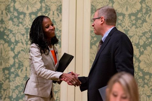 Trent Nelson  |  The Salt Lake Tribune Utah 4th Congressional District Candidates Mia Love and Doug Owens shake hands before their debate at the annual Utah Taxes Now Conference at the Grand America Hotel in Salt Lake City Tuesday May 20, 2014.