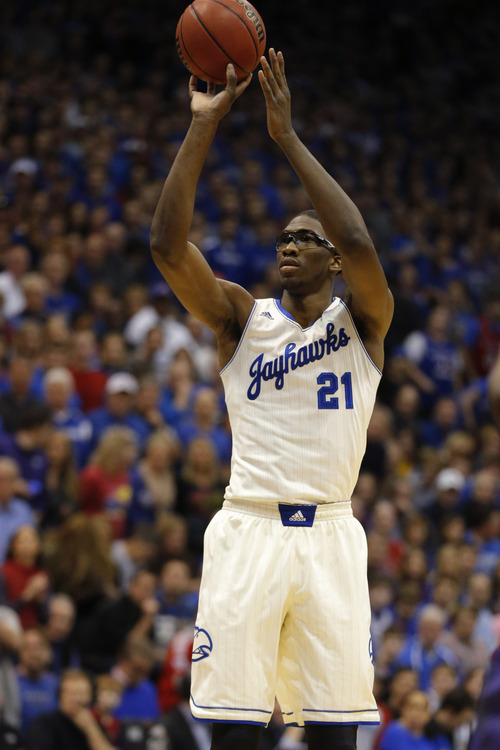Kansas center Joel Embiid during the first half of an NCAA college basketball game against Kansas State in Lawrence, Kan., Saturday, Jan. 11, 2014. (AP Photo/Orlin Wagner)