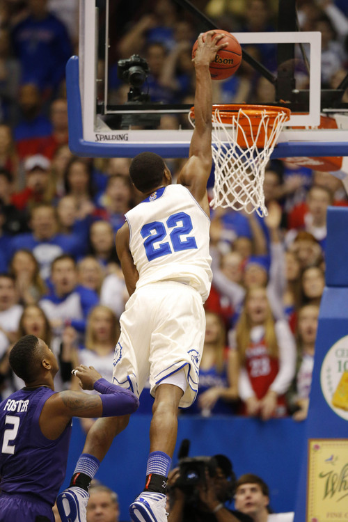 Kansas guard Andrew Wiggins (22) during the second half of an NCAA college basketball game against Kansas State in Lawrence, Kan., Saturday, Jan. 11, 2014. Kansas defeated Kansas State 86-60. (AP Photo/Orlin Wagner)