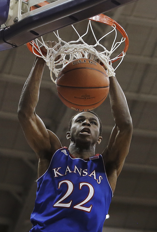 Kansas guard Andrew Wiggins (22) dunks in the first half of an NCAA college basketball game against TCU, Saturday, Jan. 25, 2014, in Fort Worth, Texas. (AP Photo/Brandon Wade)