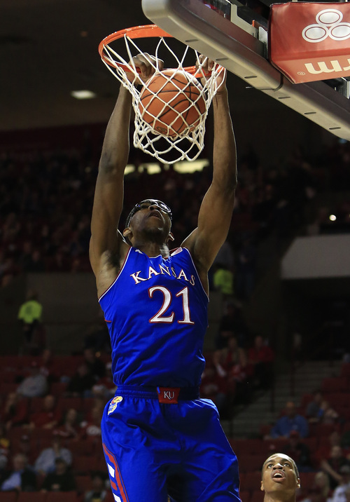 Kansas center Joel Embiid dunks against Oklahoma during the first half of an NCAA college basketball game in Norman, Okla., Wednesday, Jan. 8, 2014. (AP Photo/Alonzo Adams)