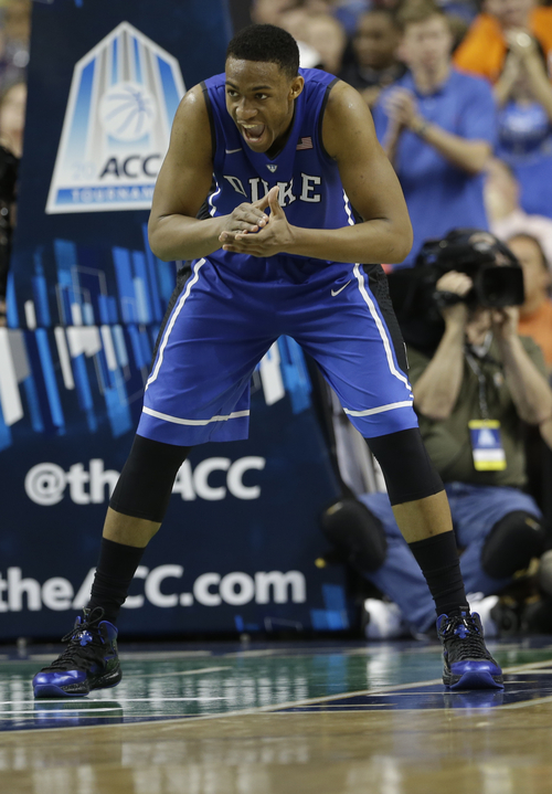 Duke's Jabari Parker (1) celebrates after making a basket against Virginia during the second half of an NCAA college basketball game in the championship of the Atlantic Coast Conference tournament in Greensboro, N.C., Sunday, March 16, 2014. (AP Photo/Gerry Broome)
