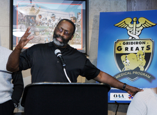 """FILE - In this May 13, 2008 file photo, former NFL player J.D. Hill gestures during a news conference in Chicago, where an initiative was announced that would help retired NFL players in dire need of medical care to receive care with millions of dollars in donated medical services through the Gridiron Greats Assistance Fund. A group of retired NFL players says in a lawsuit filed Tuesday, May 20, 2014, that the league, thirsty for profits, illegally supplied them with risky narcotics and other painkillers that numbed their injuries for games and led to medical complications down the road. """"I was provided uppers, downers, painkillers, you name it while in the NFL,"""" plaintiff J.D. Hill, who played for seven years in the 1970s, said in a statement. (AP Photo/Charles Rex Arbogast, File)"""