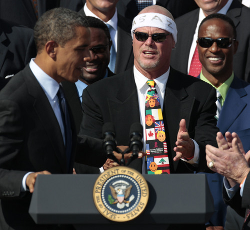 FILE - In this Oct. 7, 2011 file photo, President Barack Obama, left, looks towards quarterback Jim McMahon, wearing headband, as he honors the 1985 Super Bowl XX Champion Chicago Bears football team during a ceremony on the South Lawn of the White House in Washington. A group of retired NFL players, including McMahon, says in a lawsuit filed Tuesday, May 20, 2014, that the league illegally supplied them with risky painkillers that numbed their injuries and led to medical complications. (AP Photo/Pablo Martinez Monsivais, File)