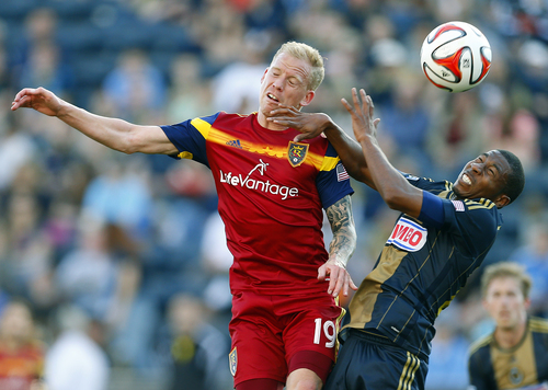 Rich Schultz | The Associated Press Real Salt Lake's Luke Mulholland, left, of England. battles Philadelphia Union's Raymon Gaddis for a header during the second half during an MLS soccer match at PPL Park in Chester, Pa., Saturday, April 12, 2014. The match ended in a 2-2 draw. (AP Photo/Rich Schultz)