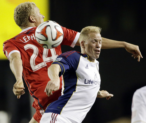 Real Salt Lake midfielder Luke Mulholland, right, vies for the ball against San Jose Earthquakes forward Steven Lenhart (24) during the second half of an MLS soccer match Saturday, March 15, 2014, in Santa Clara, Calif. The game ended in a 3-3 draw. (AP Photo/Marcio Jose Sanchez)