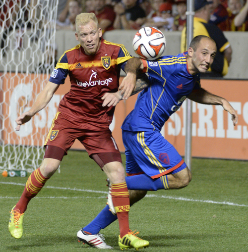 Real Salt Lake midfielder Luke Mulholland (19) collides with Colorado Rapids midfielder Nick LaBrocca (2), in MLS action, Real Salt Lake vs. The Colorado Rapids, at Rio Tinto Stadium, Saturday, May 17, 2014.      (AP Photo/The Salt Lake Tribune, Rick Egan)