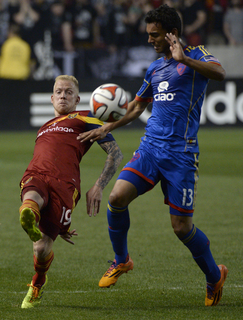 Rick Egan  |  The Salt Lake Tribune  Real Salt Lake midfielder Luke Mulholland (19) collides with Colorado Rapids forward Kamani Hill (13), in MLS action, Real Salt Lake vs. The Colorado Rapids, at Rio Tinto Stadium, Saturday, May 17, 2014.