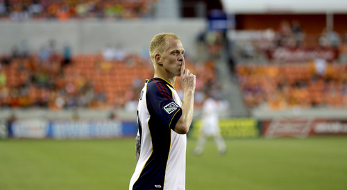 Real Salt Lake's Luke Mulholland reacts toward the crowd after scoring a goal against the Houston Dynamo during the second half of a MLS soccer game Sunday, May 11, 2014, in Houston. Real Salt Lake won 5-2. (AP Photo/David J. Phillip)