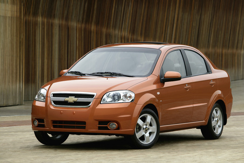 FILE - This undated file photo provided by General Motors shows the 2007 Chevrolet Aveo LT. General Motors on Wednesday, May 21, 2014 recalled 218,000 Chevrolet Aveo subcompact cars, model years 2004 through 2008. The daytime running light module in the dashboard center stack can overheat, melt and catch fire.  (AP Photo/General Motors)