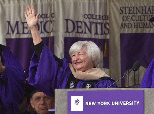 Federal Reserve Chair Janet Yellen waves to the crowd at New York University's commencement ceremony Wednesday, May 21, 2014, at Yankee Stadium in New York.  (AP Photo/Frank Franklin II)