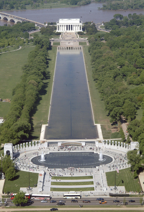 The World War II Memorial, foreground, and the Lincoln Memorial, background are seen from the Washington Monument Thursday, April 29, 2004. A national monument to the 16 million U.S. men and women who served during World War II opened to the public Thursday and immediately helped introduce another generation to the heroism that brought victory to America and its allies. (AP Photo/Lauren Burke)